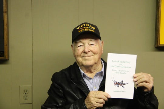 "Local author James Edward Wilson hold a copy of his book ""Just a Regular Guy and His Funny Memories."""