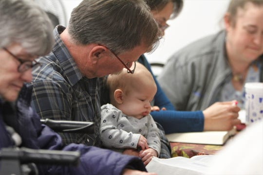 Pastor Danny Bost holds his grandson, Xander Killion, while leading a Bible study, Wednesday, Jan. 15, 2020, at New Harvest Church in Aztec.