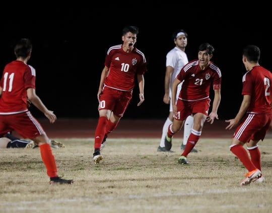 Desert Mirage High School's Jose Calderon, wearing number 10, celebrates his goals against Coachella Valley High School on January 15, 2020. Desert Mirage won 4-1.