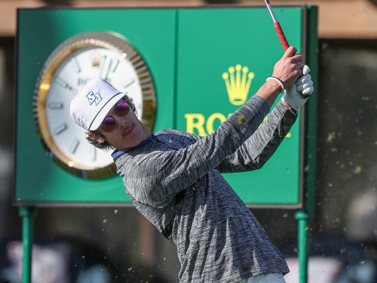 Charlie Reiter tees off on the 10th hole at La Quinta Country Club during the American Express golf tournament, January 16, 2020.