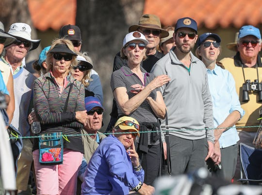 Fans react to a golf shot at La Quinta Country Club during the American Express golf tournament, January 16, 2020.