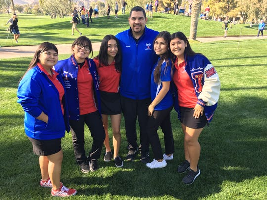 Members of the Indio girls' golf team, including coach Carlos Ayala were on hand Thursday to watch the pro golfers at The American Express.