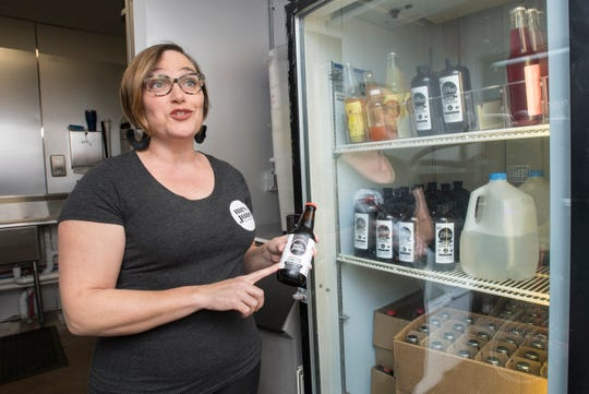 Mrs. Jones Cold Brews Coffee owner Stephanie Jones talks about their new ready to drink bottles at Nomadic's Cafe in downtown Pensacola on Wednesday, Jan. 15, 2020.