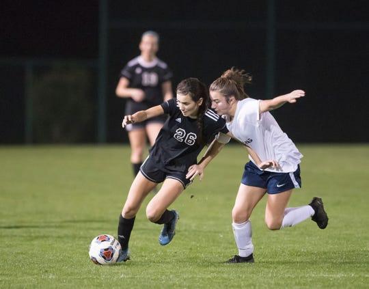Sophia Nguyen (26) dribbles past a Marlins defender during the Arnold vs Pensacola High School girls soccer at Ashton Brosnaham Park in Pensacola on Wednesday, Jan. 15, 2020.