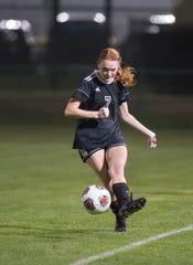 Riley Duffy (7) passes the ball during the Arnold vs Pensacola High School girls soccer at Ashton Brosnaham Park in Pensacola on Wednesday, Jan. 15, 2020.
