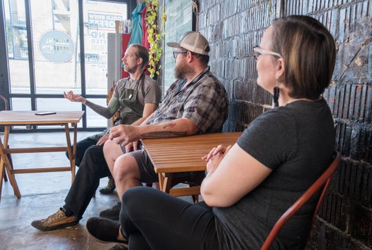 From left, Nomadic Eats owner Randy Russell, Big Jerk Soda owner Ryan Eaton, and Mrs. Jones Cold Brews Coffee owner Stephanie Jones talk about their joint venture at Nomadic's Cafe in downtown Pensacola on Wednesday, Jan. 15, 2020.