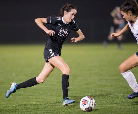 Sophia Nguyen (26) brings the ball up the field during the Arnold vs Pensacola High School girls soccer at Ashton Brosnaham Park in Pensacola on Wednesday, Jan. 15, 2020.