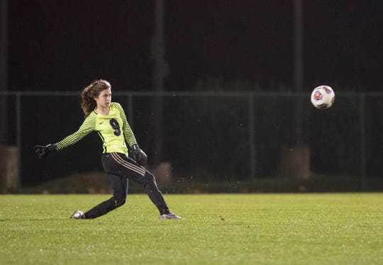 Goalie Josie Cloutier (9) kicks the ball up the field during the Arnold vs Pensacola High School girls soccer at Ashton Brosnaham Park in Pensacola on Wednesday, Jan. 15, 2020.