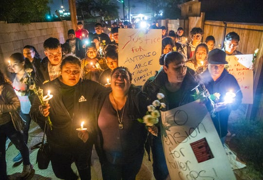 Sandra Gonzalez (center) cries out while marching with other mourners during a candlelight vigil for her son, Antonio Arce, in an alley in Tempe on Jan. 15, 2020. A year ago, a Tempe police officer shot and killed the 14-year-old while he fled with an airsoft gun.
