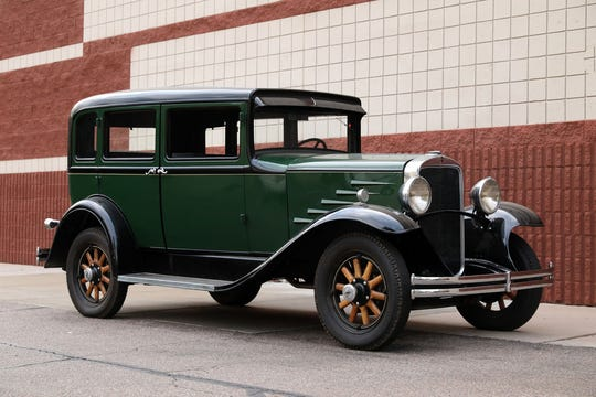 This 1930 Durant 614 Sedan comes with wood-spoke wheels, suicide doors and adark green and black exterior with gray interior.