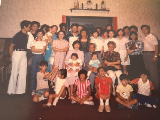 Yucca Tap Room owner Rodney Hu (bottom, first from right) celebrates Chinese New Year with his family ca. 1980s in metro Phoenix.