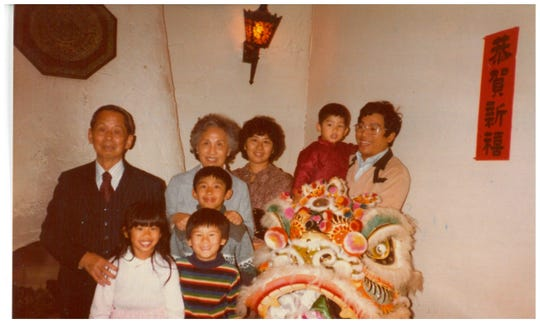 Yucca Tap Room owner Rodney Hu (in the rainbow shirt) celebrates Chinese New Year with his family ca. 1980s in metro Phoenix.