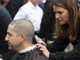 State Sen. Paul Boyer gets his head shaved by Tina Gonzalez during a press conference in support of legislation to provide legally mandated insurance coverage to firefighters who suffer from cancer brought on by exposure to carcinogenic chemicals in the line of duty. The event was held on the great lawn at the Arizona Capitol in Phoenix on Jan. 16, 2020.