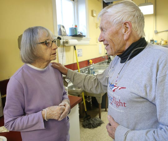 Meals on Wheels volunteers, from left, Evangeline Reilly and Frank Van Zanten greet each other during meal prep at the organization's kitchen in the City of Poughkeepsie on January 16, 2020.