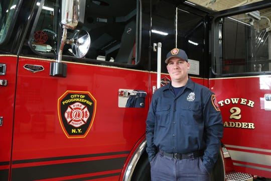 Matt Kneeter poses for a portrait in front of a City of Poughkeepsie Fire Department truck as seen on Thursday, Jan. 16, 2020.