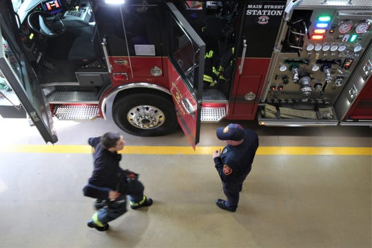 Matt Kneeter speaks with a fellow City of Poughkeepsie firefighter as he heads to a medical call on Thursday.