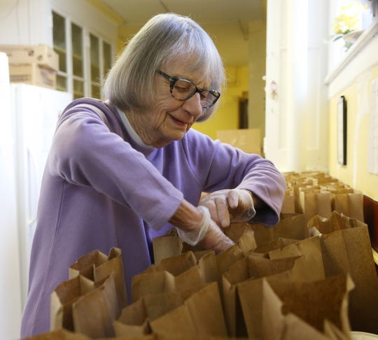 Meals on Wheels volunteer Evangeline Reilly prepares bagged suppers during meal prep at the organization's kitchen in the City of Poughkeepsie on January 16, 2020.