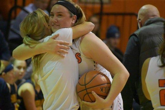 Marlboro's Erin Lofaro hugs assistant coach Katelyn Davis after Lofaro snared her 1,000th career rebound Tuesday against Highland.