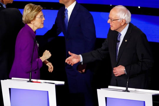 Democratic presidential candidate Sen. Elizabeth Warren, D-Mass., left and Sen. Bernie Sanders, I-Vt. talk Tuesday after a Democratic presidential primary debate hosted by CNN and the Des Moines Register in Des Moines, Iowa.