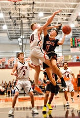 Northeastern's Andrew Brodbeck, right, takes the ball to the basket while Central York's Evan Eisenhart defends during boys' basketball action at Central York High School in Springettsbury Township, Wednesday, Jan. 15, 2020. Central York would win the game 69-67 in overtime. Dawn J. Sagert photo
