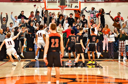 The Central York student section erupts after Central York ties up the score and taking the game into overtime during boys' basketball action at Central York High School in Springettsbury Township, Wednesday, Jan. 15, 2020. Central York would win the game 69-67 in overtime. Dawn J. Sagert photo