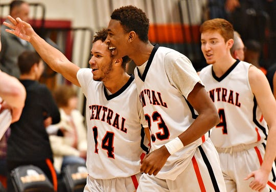 Central York celebrates a 69-67 win over Northeastern during boys' basketball action at Central York High School in Springettsbury Township, Wednesday, Jan. 15, 2020. Dawn J. Sagert photo