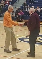 Joe Hasenfuss and Ken Stoner shake hands before Wednesday's York Suburban-Eastern York game. On Jan. 15, 1979, Hasenfuss coached York Suburban and Stoner coached Eastern York. On that day, Eastern earned a 107-106 double-overtime thriller over Suburban.