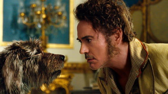 """Robert Downey Jr., right, with Jip, voiced by Tom Holland, in a scene from """"Dolittle.""""  The movie is playing at Regal West Manchester, Queensgate Movies 13 and R/C Hanover Movies."""