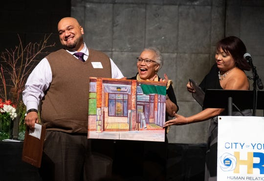 Debra Martinez (right) presents the Small Business Award to Mi Caldero Restaurant during the 2020 City of York Human Relations Commission Diversity Dinner at Logos Academy, January 15, 2020.
