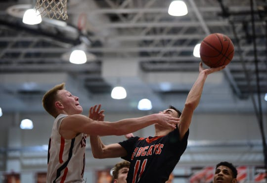 Northeastern's andrew Brodbeck goes for a layup over Central York's Evan Eisenhart. Central York won 69-67 at home in an overtime thriller Wednesday