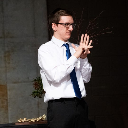 Lewis Atwater Award winner Travis Weaver uses sign language to communicate with his parents as he accepts his award during the 2020 City of York Human Relations Commission Diversity Dinner at Logos Academy, January 15, 2020.