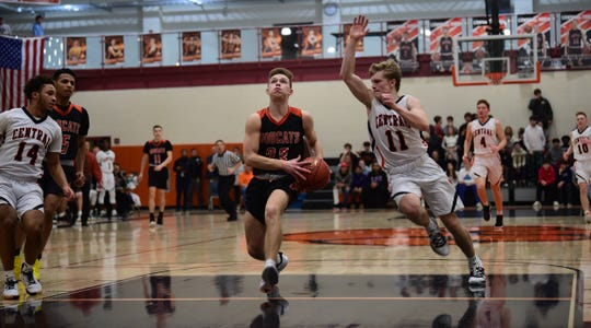 Northeastern's Austin Richards goes for a layup as Central York's Nolan Hubbs goes for a block. Central York won 69-67 at home in an overtime thriller Wednesday.
