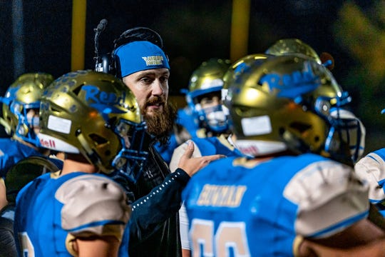 Garrett Hughes will take over as the Reed football coach.