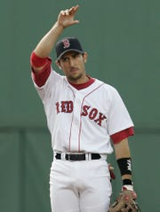 Boston Red Sox shortstop Nomar Garciaparra waves to a cheering crowd during the first inning against the San Diego Padres at Fenway Park in Boston, in this June 9, 2004 photo.