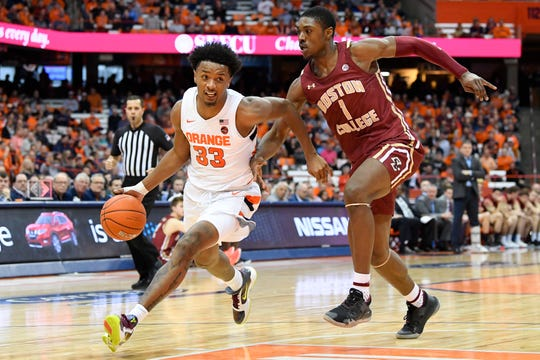 Jan 15, 2020; Syracuse, New York, USA; Syracuse Orange forward Elijah Hughes (33) drives to the basket against the defense of Boston College Eagles forward Jairus Hamilton (1) during the second half at the Carrier Dome. Mandatory Credit: Rich Barnes-USA TODAY Sports