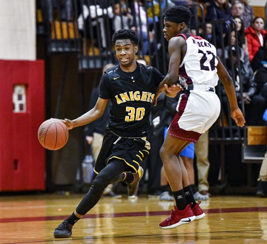 McQuaid's Kobe Long, left, is defended by Wilson's Latief Holmes during a regular season game at Wilson Magnet High School, Wednesday, Jan. 15, 2020. McQuaid beat Wilson 71-65.