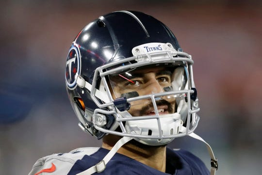 FILE - In this Nov. 24, 2019, file photo, Tennessee Titans quarterback Marcus Mariota looks at the scoreboard in the second half of an NFL football game against the Jacksonville Jaguars in Nashville, Tenn. The Tennessee Titans benched Mariota for Ryan Tannehill in mid-October after a 2-4 start.