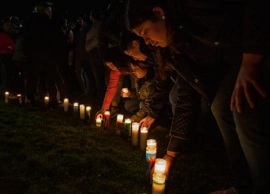 People place candles on the grass during Adrianna Annalie Vergara JuarezÕs vigil on Jan. 15, 2020.