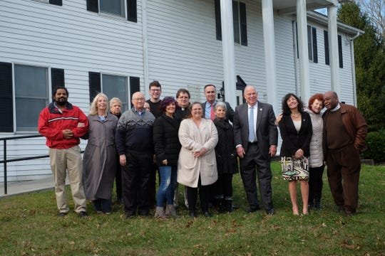 State and political officials, religious leaders in Sussex County and Love, Inc. organizers stand outside a former Delaware State Police building that will be used to shelter homeless people in Lewes and Rehoboth, on Thursday, Jan. 16, 2020.