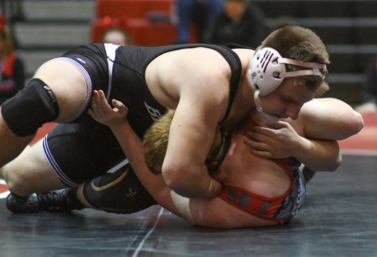 James M. Bennett Wrestler Troy Gibson (195) takes down his Colonel Richardson opponent in the first period for a pin at Bennett Wednesday January, 15, 2020. (Photo by Todd Dudek for The Daily Times)