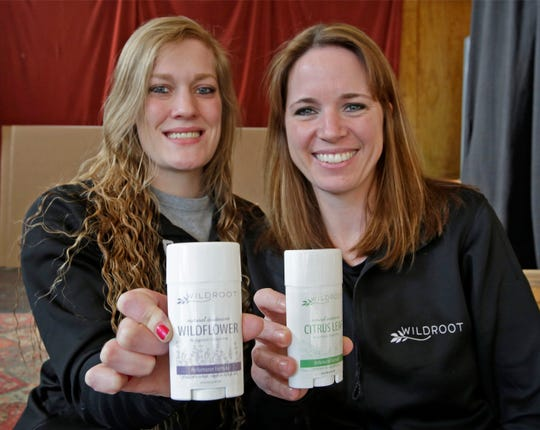 Wild Root deodorant creators Katie Spang of Kewaskum, Wis., left, and Jenny Veldkamp of Sheboygan Falls, Wis., pose with their creation Wednesday, Jan. 8, 2020, in Sheboygan, Wis.
