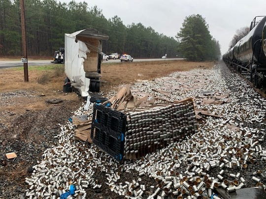 Empty tin cans are scattered near the site of a KCS train and semi-tractor trailer crash on Thursday, Jan. 16, 2020.