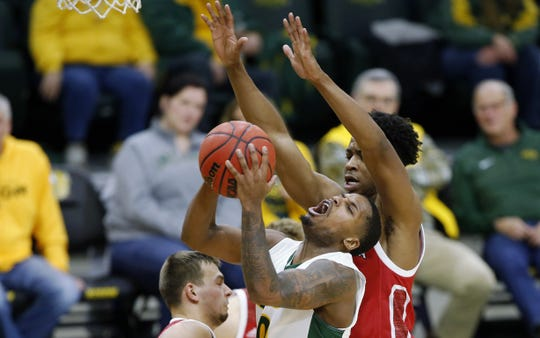 North Dakota State's Vinnie Shahid is fouled by South Dakota's Stanley Umude during their men's basketball game Wednesday, Jan. 15, in Fargo.