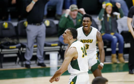 North Dakota State's Tyson Ward celebrates his game-winking basket against South Dakota during their men's basketball game Wednesday, Jan. 15, in Fargo.