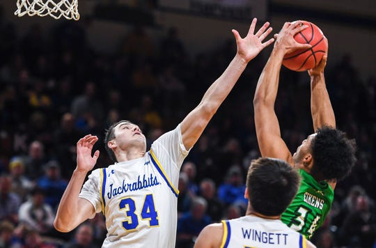 SDSU's Alex Arians (34) blocks an attempted shot made by North Dakota's De'Sean Allen- Eikens (34) on Wednesday, Jan. 15, 2020 at Frost Arena in Brookings, S.D.
