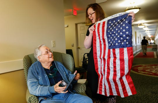 Patricia Keltner, of Compassus, presents Dorsey Levell with an award, a coin, and a flag during a ceremony honoring him at Gardens Independent Living on Tuesday, Jan. 14, 2020. Levell, the founder of Council of Churches of the Ozarks, died Jan. 22.