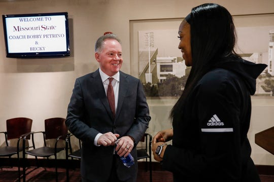 New Missouri State University Head Football Coach Bobby Petrino, left, talks with women's basketball head coach Amaka Agugua-Hamilton after a press conference at JQH Arena on Thursday, Jan. 16, 2020.