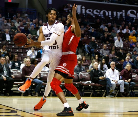 Missouri State Bears forward Tulio Da Silva (30) drives around Bradley Braves forward Ari Boya (1) as he makes a pass during a game at JQH Arena in Springfield, Mo. on Wednesday, Jan. 15, 2019.