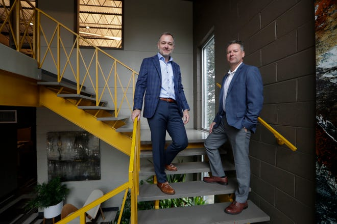 Cam Whitlock, left, and Rodney Lewis founded Architects Lewis + Whitlock together in 2000.