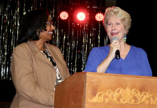 Leon County Schools Board member Rosanne Wood speaks at a Wednesday evening, Jan. 15, 2020 pep rally at Hartsfield Elementary School, congratulating the chorus on its efforts to get to Carnegie Hall. Wood stands next to the school's principal, Rhonda Blackwell-Flanagan.